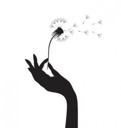dandelion in a hand vector image vector image