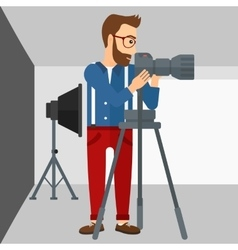 Photographer working with camera on a tripod vector