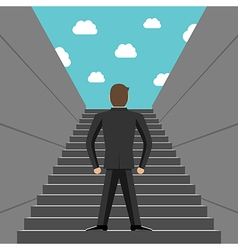 Ambitious businessman climbing steps vector image