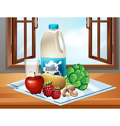 Milk and fresh vegetables on table vector image