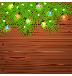 Christmas tree branches and light bulb on wooden vector