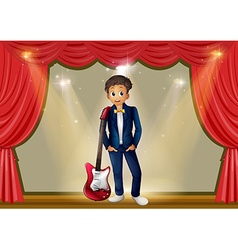Man with guitar on stage vector image