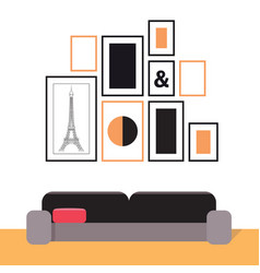 Picture frames on the wall and a sofa interior vector