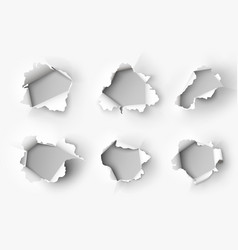 Holes torn in paper on white vector