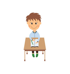flat schoolboy sitting at desk isolated vector image