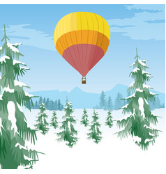 air balloon flying over forest in snowy valley vector image vector image