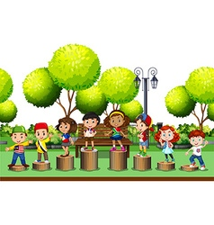 Children standing on log in the park vector image