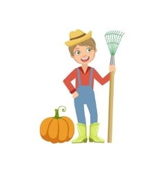 Boy dressed as farmer with pumpkin and rake vector