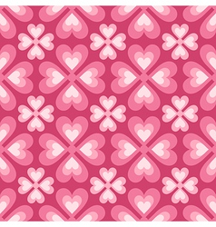 Seamless pattern of stylized flowers and hearts vector