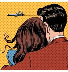 Loving couple looking at a plane taking off in the vector