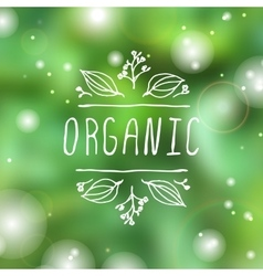 Organic - product label on blurred background vector image