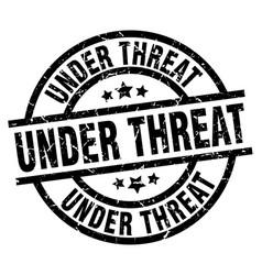 Under threat round grunge black stamp vector