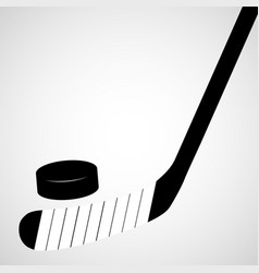 Hockey stick and puck isolated on a white vector