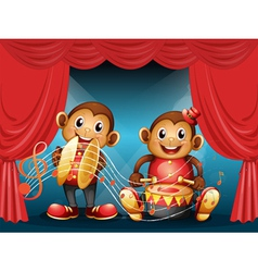 Two monkeys performing at the stage vector