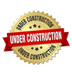 Under construction 3d gold badge with red ribbon vector