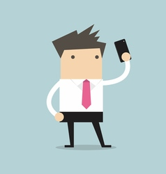 Businessman taking selfie using a mobile phone vector image