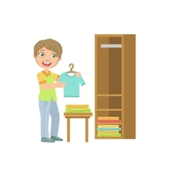 Boy putting clean clothes in dresser vector