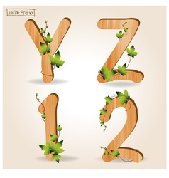 wood alphabet with branch green leaves vector image