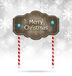 Snow covered wooden sign Merry Christmas vector image vector image