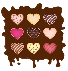 set of the sweetmeats in form heart on chocolate vector image