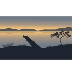Silhouette of pier in lake vector image