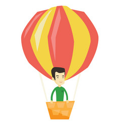 Young man flying in hot air balloon vector