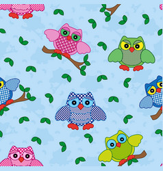 Seamless pattern with ornamental owls over blue vector