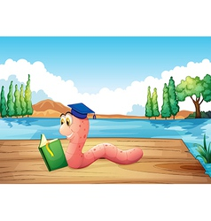 A worm reading a book near the pond vector