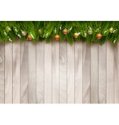 Christmas tree branches with baubles on a wooden vector