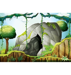 Cave in the deep forest vector