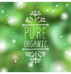 Pure organic - product label on blurred background vector image vector image