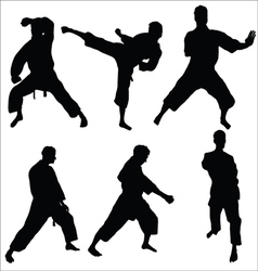 Karate pose sihouettes vector