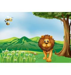 A lion and a flying bee at the hills vector