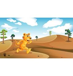A tiger running in the desert vector