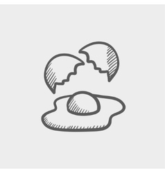 Broken egg with yolk sketch icon vector