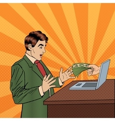 Pop art business man receiving money from laptop vector
