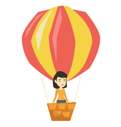 Asian woman flying in hot air balloon vector