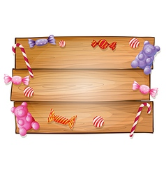 An empty signboard with candies vector image