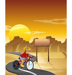 A biker at the desert with an empty signboard vector