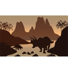 Silhouette of ankylosaurus in river vector