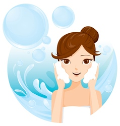 Young woman washing face with foam vector