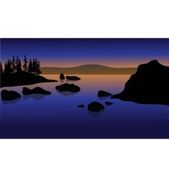 At Sunset in beach with rock silhouette vector image vector image