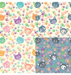 Seamless background cat faces vector image vector image
