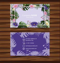 Businesscard template with flowers on purple vector