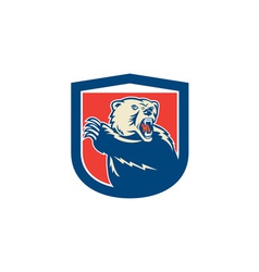 Grizzly bear swiping paw shield retro vector