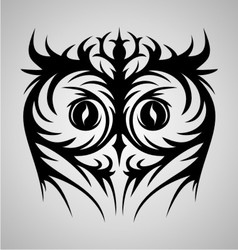Owl face tribal vector