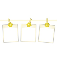 Blank photos with yellow flowers on clothesline vector
