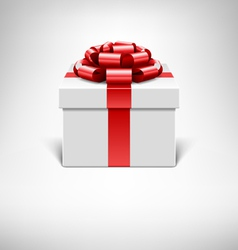 White gift box with red ribbon vector