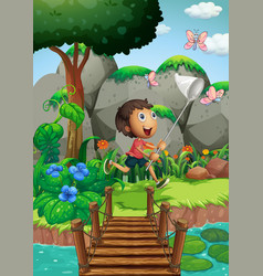 Scene with boy catching insects in garden vector