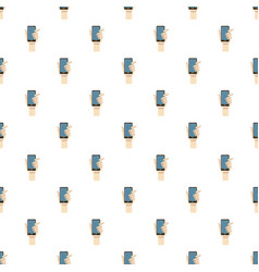 Mobile phone in hand pattern vector